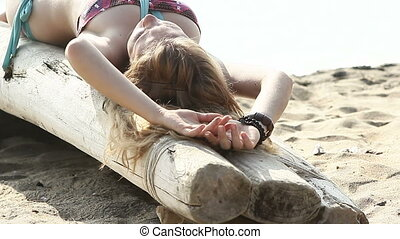 girl in swimming suit tanning on wooden small boat - girl in...