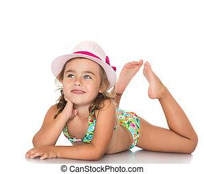 Girl in swimsuit sunbathing