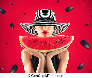 Girl in swimsuit with watermelon in hand and red background with seeds