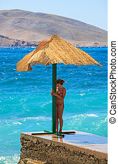 Girl in the Baska beach, Croatia - Girl under the umbrella...