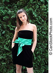 Girl in the black dress with green