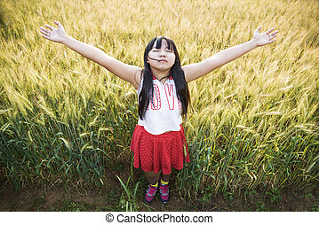Girl in the field of golden wheat.