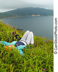 girl in the grass against sea landscape