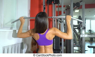 Girl in the gym. Slow motion - Beautiful girl is training on...