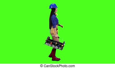 Girl in the helmet and the shirt goes sideways on a green background. Slow motion
