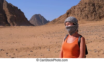 Girl in the Keffiyeh in Desert of Egypt. Portrait of a...