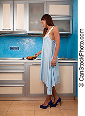 Girl in the kitchen takes fruit