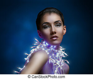 girl in the lights - a beauty girl on the dark background