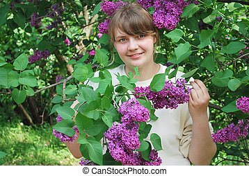 girl in the lilac bushes