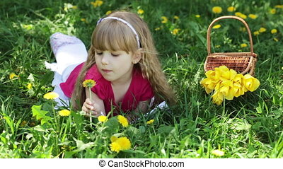 Girl in the meadow of dandelions. S