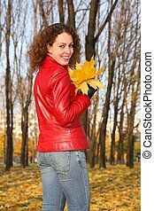 girl in the park in autumn with yellow leaves