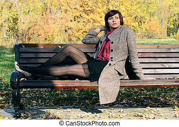 Girl in the park on a bench