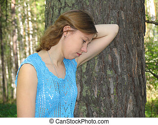 Girl in the pine forest