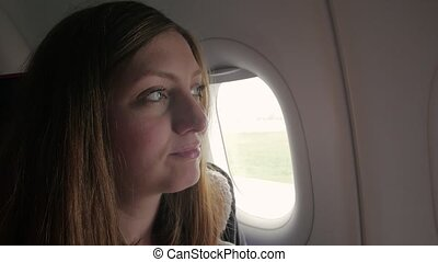 Girl In The Plane Before Take Off
