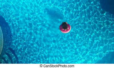 girl in the pool. drone view