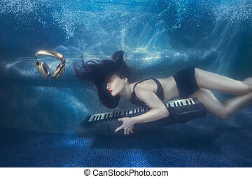 Girl in the pool with a piano.