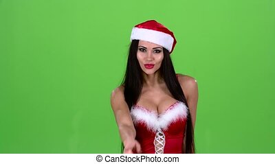 Girl in the red suit of the snow maiden scolds and points her finger a little more quietly. Green screen