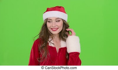 Girl in the red suit of the snow maiden sends an air kiss. Green screen. Close up. Slow motion