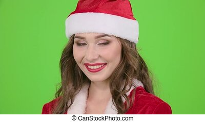 Girl in the red suit of the snow maiden sends an air kiss. Green screen. Close up