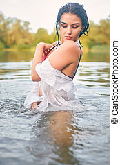 girl in the river in a white shirt , one
