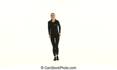 Girl in the room in the white room jumps. White background
