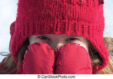 Girl in the snow - Cute little girl hiding behind her hand