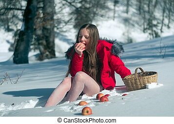 Girl in the snow with apples