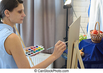 Girl in the studio draws still life watercolor