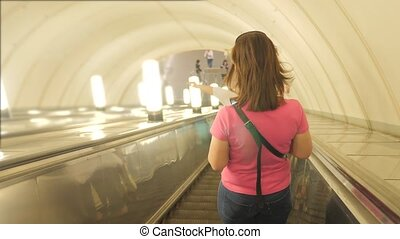 girl in the subway underground metro concept. People stand...