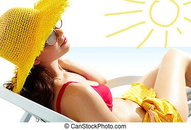 Girl in the sun - Portrait of a girl lying in the sun in...