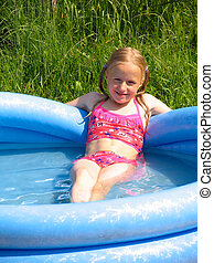 Girl in the swimming-pool