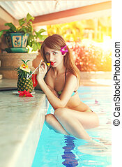 Girl in tropical pool bar