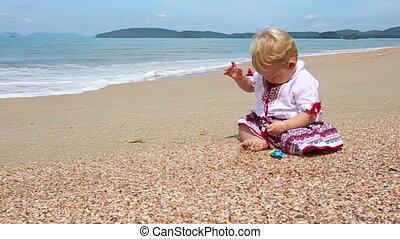 girl in Ukrainian costume embroidery on beach