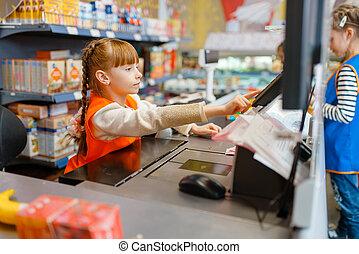 Girl in uniform at the cash register, playroom