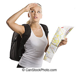 blond young woman carrying a backpack with map looking up