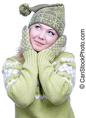 portrait of beautiful dreamy blonde girl in green sweater, mittens and winter cap with bob