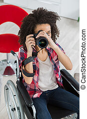 girl in wheelchair takes a picture
