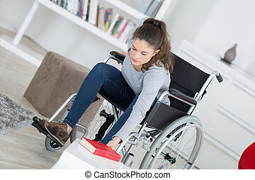 girl in wheelchair with book