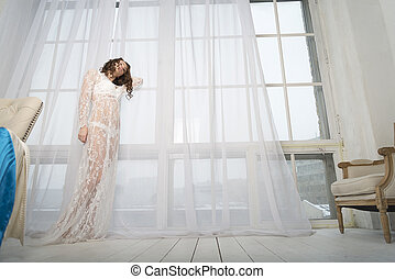 Girl in white at the window.