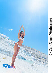 girl in white bikini on limestone