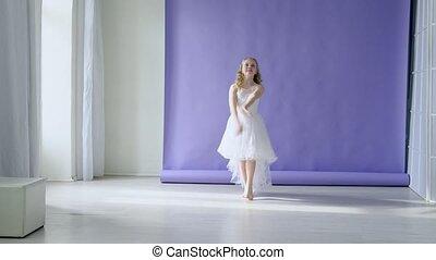 Girl in white dress dances music - Girl in white dress...