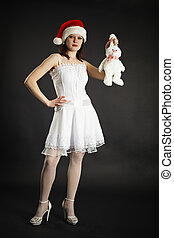 Girl in white dress holding white rabbit