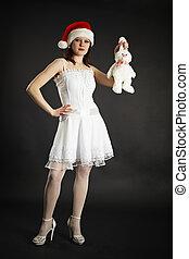 Girl in white dress holding white rabbit