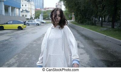 Girl in white dress is taking a walk