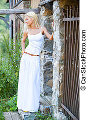 girl in white dress on a summer day