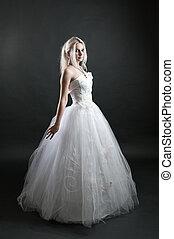 Girl in white dress on black background