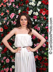 Girl in white dress on floral background