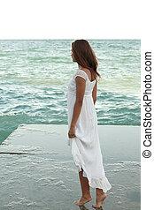 girl in white dress on the beach
