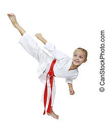 Girl in white kimono beats kicking isolated background