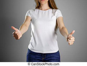 Girl in white t-shirt and blue jeans. Shows two hands thumbs up. Closeup. Isolated